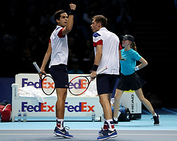 Pierre-Hugues Herbert and team mate Nicolas Mahut celebrate winning the second set during their doubles match against Horia Tecau and Jean-Julien Rojur during day one of the NITTO ATP World Tour Finals at the O2 Arena, London.