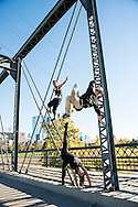 Red Bull Flying Bach dancers perform on the South Platte River Trail bridge in Denver, CO, USA, on 21 October, 2016.