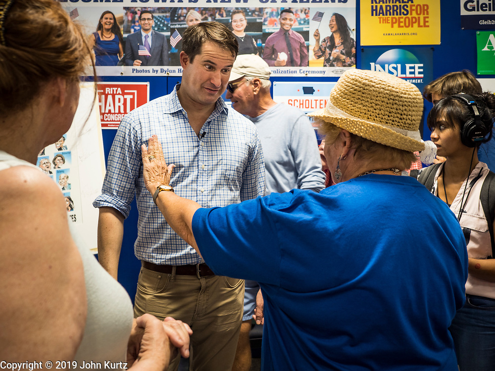 17 AUGUST 2019 - DES MOINES, IOWA: Representative SETH MOULTON (D-MA), left, campaigns at the Iowa State Fair Saturday.  Moulton, a US Marine veteran who served in Iraq, is running to be the Democratic candidate for the US Presidency in 2020 and spent Saturday campaigning at the fair. Iowa traditionally hosts the the first selection event of the presidential election cycle. The Iowa Caucuses will be on Feb. 3, 2020.          PHOTO BY JACK KURTZ