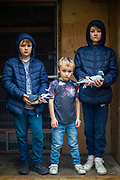 Mason, Leon and Ashton, the youngest fanciers inside the loft with their pigeons.