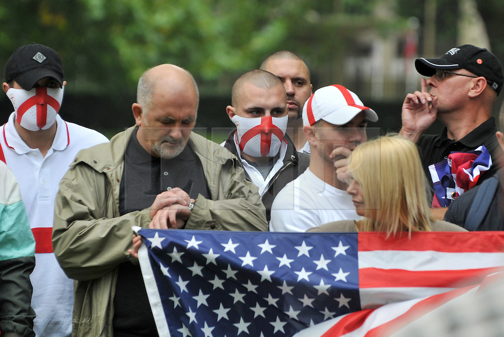 CENTRAL LONDON. Members of the English Defence League hold a minute silence. Family and friends of those killed in the World Trade Centre attacks in New York in 2001 visit the memorial to the British victims in Grosvenor Square.  11 September 2010. STEPHEN SIMPSON.