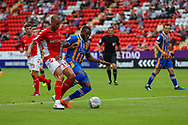 Charlton Athletic midfielder Darren Pratley (15) and Shrewsbury Town forward Lenell John-Lewis (14) battle for the ball during the EFL Sky Bet League 1 match between Charlton Athletic and Shrewsbury Town at The Valley, London, England on 11 August 2018.