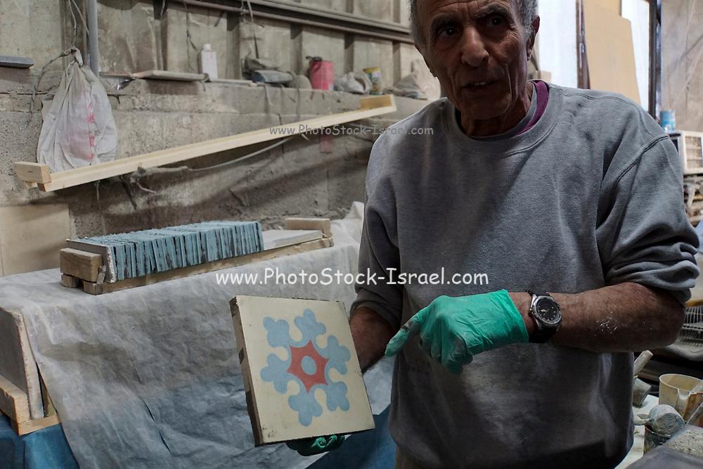 Traditional crafts set. Painted floor tiles manufacturer. Photographed in Tel Aviv, Israel