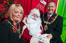 Mayor of Rotherham Cllr Shaun Wright JP and the  Mayoress of Rotherham Mrs Lisa Wright are the first to visit Santa at Parkgate Retail World on Friday Morning after he opened the Grotto run by RS Leisure 114495-3.11 November 2011. Image © Paul David Drabble