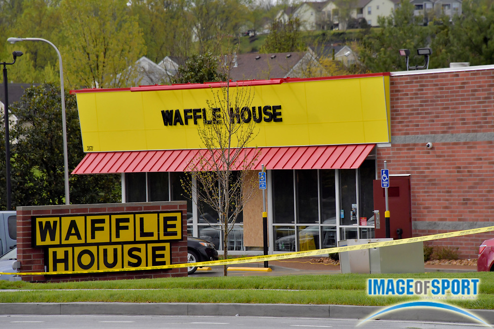 Police tape continues to surround the Waffle House on Murfreesboro Road on Monday, April 23, 2018 in Nashville, Tenn. after a shooting on Sunday morning. Travis Reinking is the suspect in the shooting at the Waffle House restaurant Sunday in Nashville that resulted in the death of four people.(Jim Brown\IOS via AP)