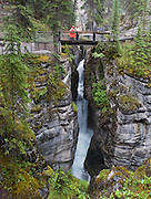 Hiking Lower Maligne Canyon is worthwhile even in the rain, in Jasper National Park, Alberta, Canada. Jasper is part of the Canadian Rocky Mountain Parks World Heritage Site declared by UNESCO in 1984. Stitched from 2 overlapping images.