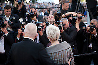 Tonie Marshall and Jean Paul Gaultier pose for photographers at the gala screening for the film Mal De Pierres (From the Land of the Moon) at the 69th Cannes Film Festival, Sunday 15th May 2016, Cannes, France. Photography: Doreen Kennedy