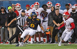 Sep 8, 2018; Morgantown, WV, USA; West Virginia Mountaineers wide receiver Marcus Simms (8) runs after a catch during the second quarter against the Youngstown State Penguins at Mountaineer Field at Milan Puskar Stadium. Mandatory Credit: Ben Queen-USA TODAY Sports