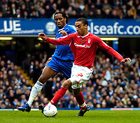 Photo: Ed Godden/Sportsbeat Images.<br /> Chelsea v Nottingham Forest. The FA Cup. 28/01/2007. <br /> Chelsea's Didier Drogba (L), is held off the ball by James Perch.