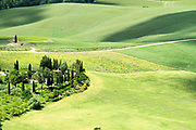 Rolling green hills with farmhouse and trees Photographed in Umbria, Italy