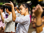 03 APRIL 2018 - CHIANG MAI, THAILAND: A teenager rehearses a traditional dance before Songkran in Chiang Mai, Thailand.  Songkran is the traditional Thai New Year festival and is celebrated April 13-15. The holiday is best known for raucous water fights but it is an important cultural and religious holiday.       PHOTO BY JACK KURTZ