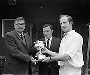 18/07/1970<br /> 07/18/1970<br /> 18 July 1970<br /> Cricket: Clontarf 1st XI v Old Belvedere, Leinster Senior Cup Final at Clontarf Cricket Club, Castle Avenue, Dublin. Mr. Allen O'Donnell (left), Past President L.C.U., presenting the trophy to Mr. Tim O'Brien, Captain of Old Belvedere 1st XI, winners of the Leinster Senior Cup Final. Centre is Mr. Dermot Byrne, Brand Manager, Player-Wills, sponsors of the finals.