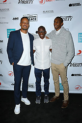 J Erving III, left, Troy Carter and guest at Creative Community For Peace 2nd Annual 'Ambassadors Of Peace' Gala held at Los Angeles on September 26, 2019 in Private Residence, California, United States (Photo by © Jc Olivera/VipEventPhotography.com