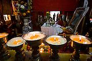Candles illuminate part of the Lhasaani Tsang Kung Nunnery in Lhasa, Tibet.