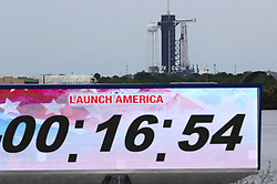 The Space X Falcon 9 rocket carrying two astronauts in the Crew Dragon capsule sits on the launch pad at Kennedy Space Center, FL, USA, Wednesday, May 27, 2020, as the countdown clock shows the time it was stopped because the launch was scrubbed due to weather. Photo by Joe Burbank/Orlando Sentinel/TNS/ABACAPRESS.COM