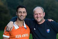 BLOEMENDAAL -  coach Michel van den Heuvel (Bldaal) met Glenn Schuurman (Bldaal).   Heren I, seizoen 217-2018. COPYRIGHT KOEN SUYK