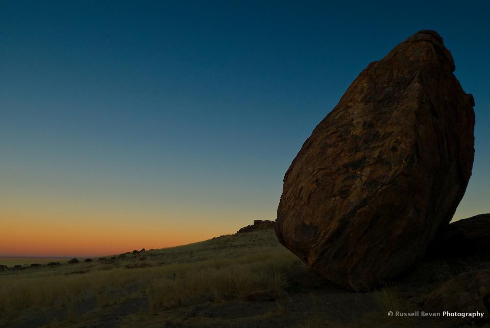 Large Rock with sunrise, Mirabib, Namibia