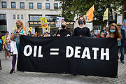 'Oil = Death' banner at the Extinction Rebellion 'Shell Out' protest on 8th September 2020 in London, United Kingdom. The environmental group gathered outside the Shell building to protest at the ongoing extraction of fossil fuels and the resulting environmental record. Extinction Rebellion is a climate change group started in 2018 and has gained a huge following of people committed to peaceful protests. These protests are highlighting that the government is not doing enough to avoid catastrophic climate change and to demand the government take radical action to save the planet.