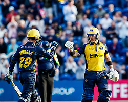 Colin Ingram of Glamorgan celebrates a boundary with team-mate Owen Morgan<br /> <br /> Photographer Simon King/Replay Images<br /> <br /> Vitality Blast T20 - Round 1 - Glamorgan v Somerset - Thursday 18th July 2019 - Sophia Gardens - Cardiff<br /> <br /> World Copyright © Replay Images . All rights reserved. info@replayimages.co.uk - http://replayimages.co.uk