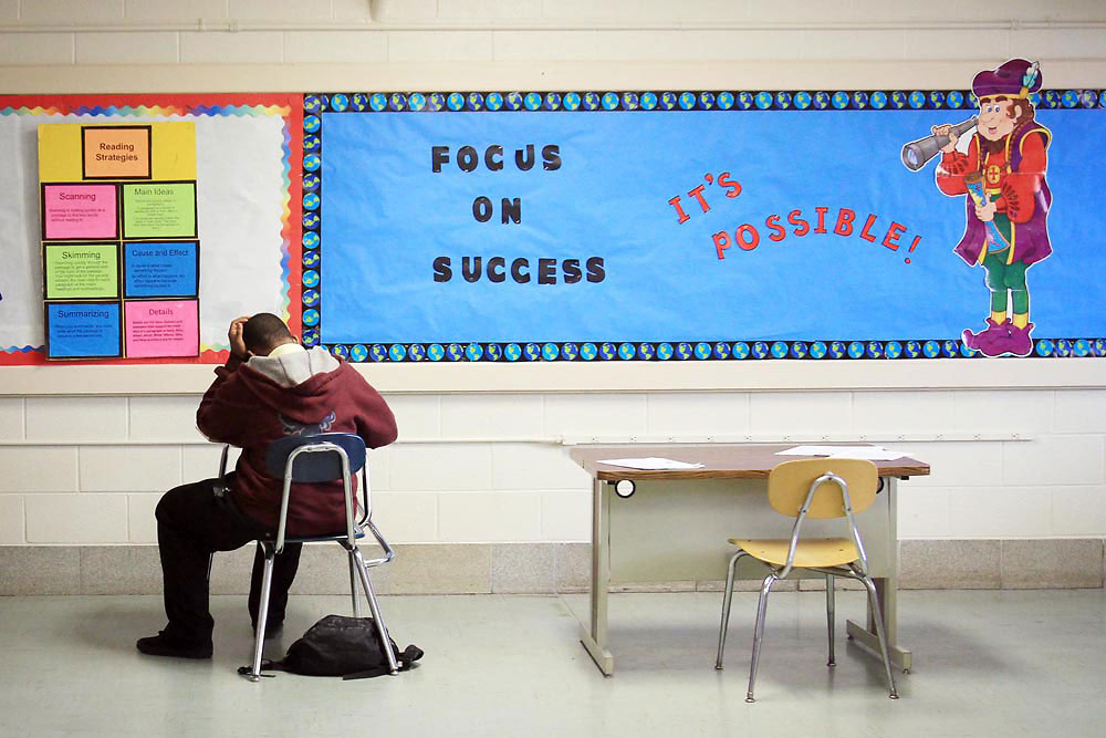 A middle school student works on a packet of school work on Monday while attending the H.O.P.E. program currently housed out of the former Rocky Mount High School.