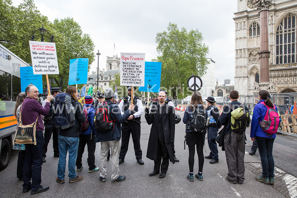 London, UK. 3 May, 2019. Protesters from the Peace Pledge Union and faith groups are contained by police officers as guests leave Westminster Abbey following a National Service of Thanksgiving to mark fifty years of the Continuous at Sea Deterrent (CASD) attended by dignitaries including the Duke of Cambridge and the newly appointed Defence Secretary Penny Mordaunt.