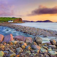Historical Cottage at Waterville Beach, Coastline of Ring of Kerry - House near Waterville during sunset Ireland / wv003a