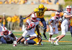 Sep 14, 2019; Morgantown, WV, USA; North Carolina State Wolfpack running back Zonovan Knight (24) runs the ball during the third quarter against the West Virginia Mountaineers at Mountaineer Field at Milan Puskar Stadium. Mandatory Credit: Ben Queen-USA TODAY Sports