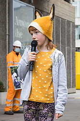 A child makes a moving speech about the environmental damage being caused by the HS2 high-speed rail link during a HS2 Chainsaw Massacre protest outside the Among The Trees exhibition at the Hayward Gallery on 30 October 2020 in London, United Kingdom. The protest, during which many activists were dressed as HS2 enforcement agents and workers, was intended to highlight both the environmental destruction required for the controversial project and instances of violence and brutality by security guards and bailiffs working on behalf of HS2 Ltd.