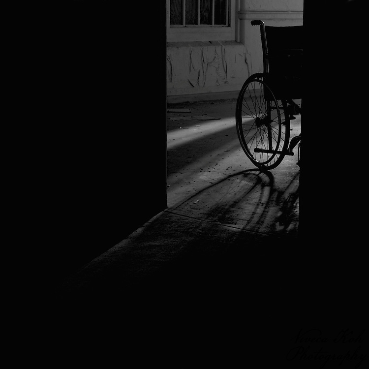 Wheelchair in a shadowy doorway