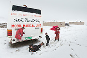Failed aid examples in the Pamir abounds, but this is one of the most stricking: A Medical Unit Bus bus brought, with special authorisation, from the Tajikistan side in summer 2007 (an Afghan-Pakistan project) to provide medical help. After a month, the ?doctor? left back to Tajikistan. Since then, the bus is rotting away beside the Khan's camp..Inside there is expired medicine thrown all over the floor...Trekking through the high altitude plateau of the Little Pamir mountains, where the Afghan Kyrgyz community live all year, on the borders of China, Tajikistan and Pakistan.