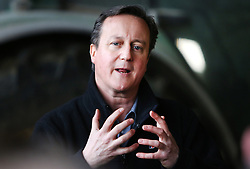 Licensed to London News Pictures. 27/02/2016. Ahoghill, County Antrim, Northern Ireland, UK. Prime Minister David Cameron speaks to farmers during a tour of Harry Johnston dairy farm in Ahoghill, County Antrim. The Prime Minister was on a tour to persuade voters that membership of a reformed EU is in their best interests. Photo credit : Paul McErlane/LNP
