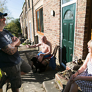 Locals enjoy the sun after a long day protesting at the site nearby. Day of protest in Pont Valley 5 May 2018 against the extraction of coal by the mining company Banks outside Dipton in Pont Valley, County Durham. Locals have fought the open cast coal mine for thirty years and three times the local council rejected planning permissions but central government has overruled that decision and the company Banks was granted the license and rights to extract coal in early 2018. Locals have teamed up with climate campaigners and together they try to prevent the mining from going ahead. The mining will have huge implications on the local environment and further coal extraction runs agains the Paris climate agreement. A rare species of crested newt live on the land planned for mining and protectors are trying to stop the mine to save the newt.