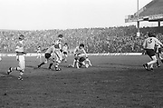 Dublin tackles Kerry to the ground during the All Ireland Senior Gaelic Football Semi Final, Dublin v Kerry in Croke Park on the 23rd of January 1977. Dublin 3-12 Kerry 1-13.