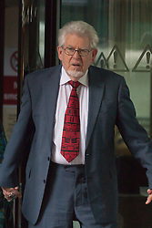 London, June 27th 2014. With the jury still to reach a verdict on the 12 charges of indecent assault against girls aged between 7 and 19, at the end of their 7th day in retirement, Rolf Harris, who denies the charges, leaves court.