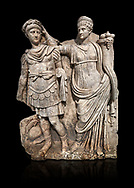 Roman Sebasteion relief  sculpture of Nero being crowned emperor by Agrippina, Aphrodisias Museum, Aphrodisias, Turkey.   Against a black background.<br /> <br /> Agrippina crowns her young son Nero with a laurel wreath. She carries a cornucopia, a symbol of Fortune and Plenty, and he wears the armour and cloak of a Roman commander, with a helmet on the ground near his feet. The scene refers to Nero's accession as emperor in AD 54, and belongs before AD 59 when Nero had Agrippina murdered. .<br /> <br /> If you prefer to buy from our ALAMY STOCK LIBRARY page at https://www.alamy.com/portfolio/paul-williams-funkystock/greco-roman-sculptures.html . Type -    Aphrodisias     - into LOWER SEARCH WITHIN GALLERY box - Refine search by adding a subject, place, background colour, museum etc.<br /> <br /> Visit our ROMAN WORLD PHOTO COLLECTIONS for more photos to download or buy as wall art prints https://funkystock.photoshelter.com/gallery-collection/The-Romans-Art-Artefacts-Antiquities-Historic-Sites-Pictures-Images/C0000r2uLJJo9_s0