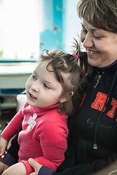 Valentina, 34, and her daughter Shezhana, 4, watch as Shezhana's sister Diana is examined by Dr Galina Piskunova at an MSF mobile clinic run in the Zorinsk health centre near Lugansk.