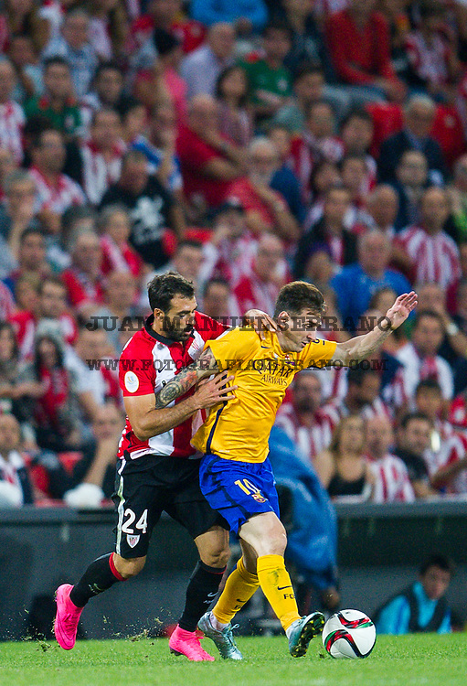 BILBAO, SPAIN - AUGUST 14:  Lionel Messi of FC Barcelona duels for the ball withÊMikel Balenziaga of Athletic Club during the Super Cup first leg match between of Athletic Club and FC Barcelona at San Mames Stadium on August 14, 2015 in Bilbao, Spain.  (Photo by Juan Manuel Serrano Arce/Getty Images)
