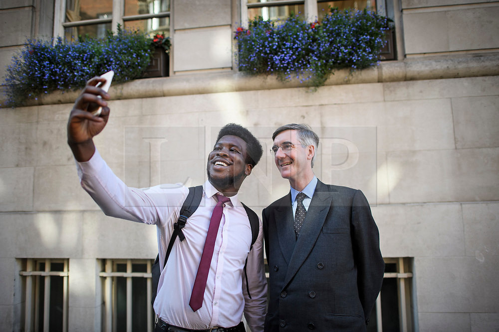 © Licensed to London News Pictures. 29/08/2019. London, UK. Leader of the House of Commons JACOB REES-MOGG is seen posing for a selfie with an admirer, at Milbank Studio in Westminster. The government has asked the Queen to suspend Parliament in the days after MPs return to work in September - a few weeks before the Brexit deadline of October 31st. Photo credit: Ben Cawthra/LNP