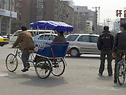 rickshaw in the streets of Beijing China