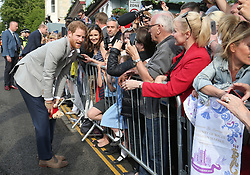 Prince Harry meet members of the public outside Windsor Castle ahead of his wedding to Meghan Markle this weekend.