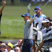 Jordan Spieth, USA, tees off and signals a wayward shot with Jason Day, (left), Australia, and Bubba Watson, USA, during The Barclays Golf Tournament at The Plainfield Country Club, Edison, New Jersey, USA. 27th August 2015. Photo Tim Clayton