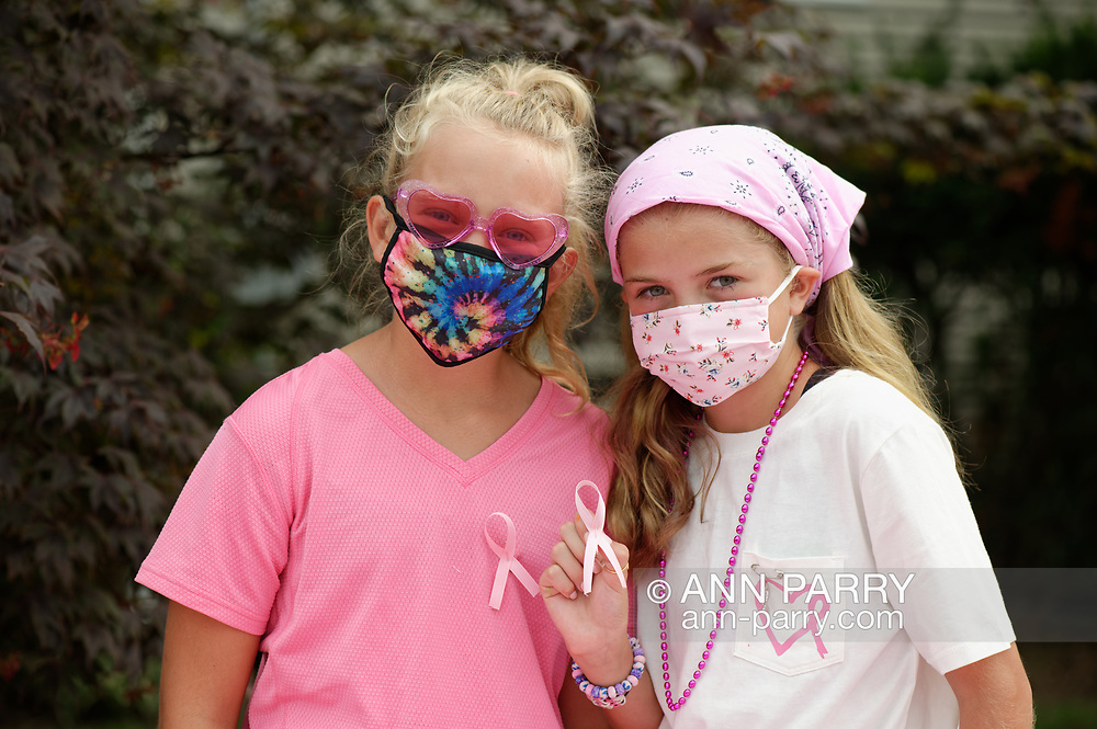 Merrick, New York, U.S. August 15, 2020. Tweens, L-R, REESE wears a pink ribbon and friend ANNIE FITZPATRICK holds one, during sale of shells Lizzie's Army painted to raise funds to donate to American Cancer Society Making Strides Against Breast Cancer. When Annie's 24-year-old sister Lizzie Fitzpatrick was diagnosed with Triple Negative Breast Cancer in late June, Annie and two others formed Lizzie's Army. Over $3,000 has been raised so far through shell sales and GoFundMe.