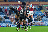 Burnley defender Kevin Long (28) heads the ball towards goal but goes high over the cross bar during the The FA Cup 3rd round match between Burnley and Barnsley at Turf Moor, Burnley, England on 5 January 2019.