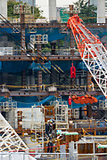 Construction workers and cranes building the 2020 Tokyo Olympic Stadium in Gaiemmae, Tokyo, Japan. Friday October 6th 2017