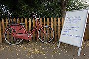Spectator's bike locked up on a picket fence next to sign asking bicycles to be stored nearby at the local station on the first day of competition of the London 2012 Olympic 250km mens' road race. Starting from central London and passing the capital's famous landmarks before heading out into rural England to the gruelling Box Hill in the county of Surrey. Local southwest Londoners lined the route hoping for British favourite Mark Cavendish to win Team GB first medal but were eventually disappointed when Kazakhstan's Alexandre Vinokourov eventually won gold.