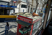 A toy Scooby Doo cartoon character lies on the roof of a newspaper and magazine kiosk during the third lockdown of the Coronavirus pandemic, on 29th March 2021, in London, England.