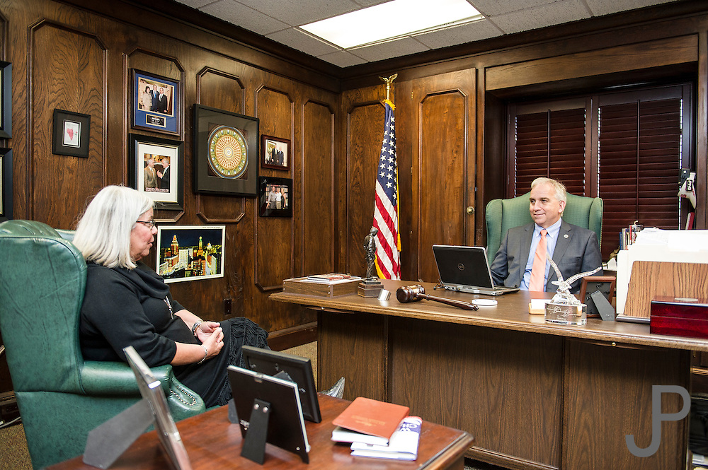 Oklahoma Secretary of State Chris Benge discussing his schedule with Executive Assistant Tookie Hayes.