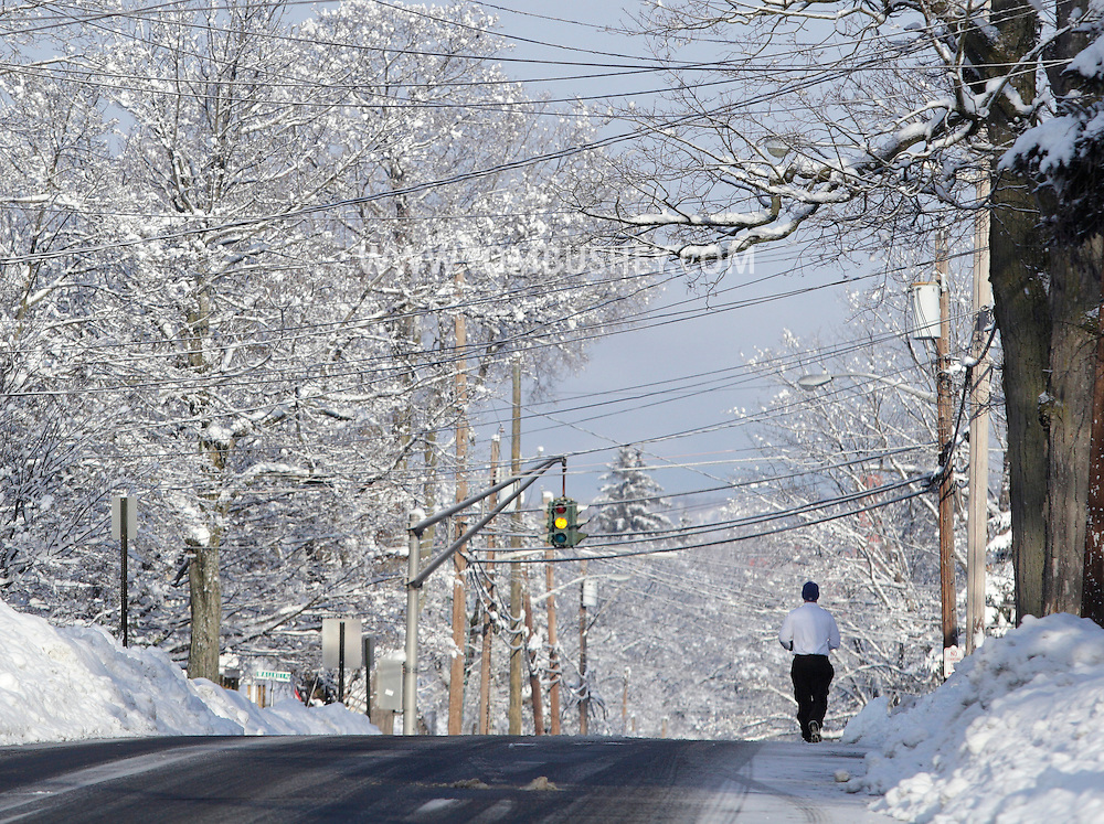 Middletown, New York - A man goes for a run on Lake Street the morning after a snowstorm dumped two feet on snow on the area on Feb. 26, 2010.