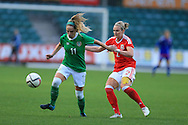 Julie -Ann Russell of Rep of Ireland is tackled by Rhiannon Roberts of Wales. Friendly International Womens football, Wales Women v Republic of Ireland Women at Rodney Parade in Newport, South Wales on Friday 19th August 2016.<br /> pic by Andrew Orchard, Andrew Orchard sports photography.