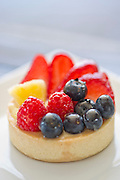 A mixed berry fruit tart on a plate at a bakery at Meridienne Dessert Salon and Cafe in Rogers, Arkansas.